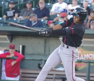 Dalton Pompey takes a swing for the Lansing Lugnuts