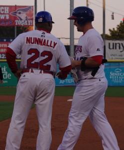 First base coach and hitting coach Jon Nunnally greets Brad Glenn at first base in Buffalo in 2013